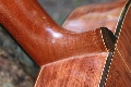 Steel String Guitar: Steel String heel detail.